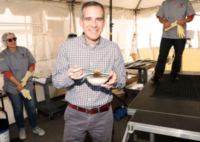 Mayor Eric Garcetti enjoying a delicious bowl of Juanita's Menudo